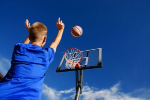 bigstock-playing-basketball-15064337