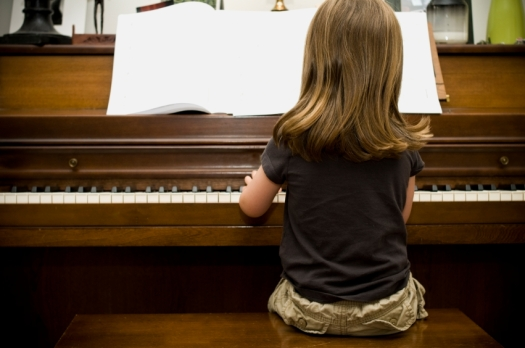 little-girl-alone-at-the-piano